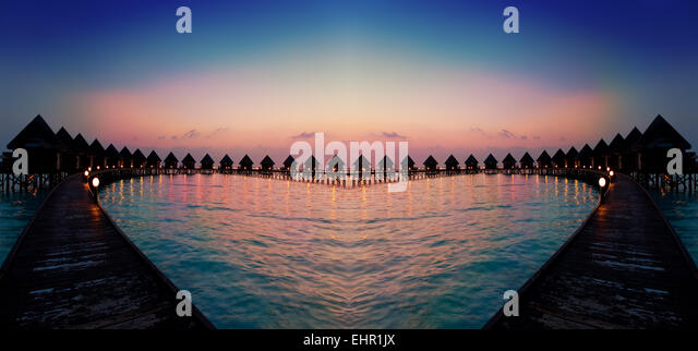 houses on piles on water at night - Stock-Bilder