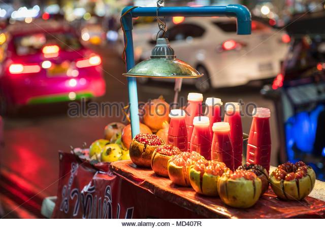 Pomegranate juice at street food stall, Bangkok, Thailand - Stock Image