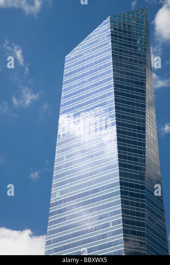 Clouds reflecting in windows of modern skyscraper, Madrid, Spain - Stock Image