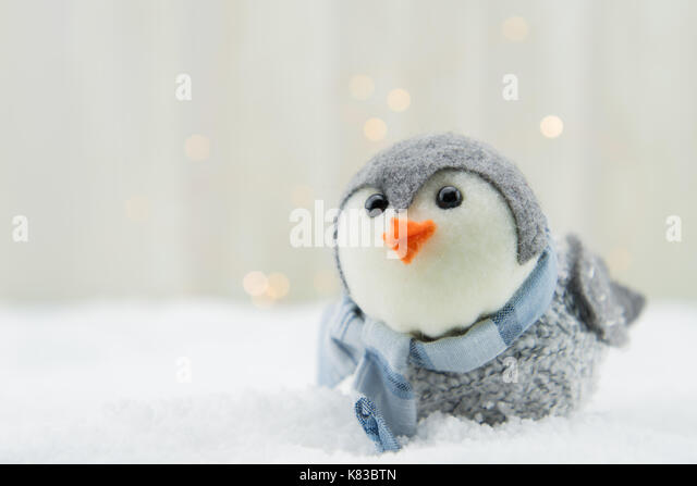 Felt Bird Ornament with Copy Space to Left Over Snow Close Up - Stock Image