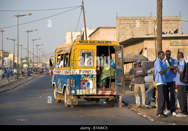 Colorfully painted buses roam the streets of Dakar, Senegal. - Stock Image