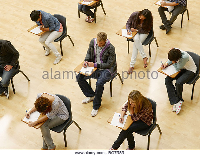 College students taking test in classroom - Stock-Bilder