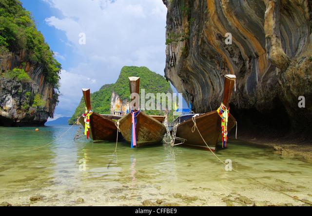 Tropical beach, longtail boats, Andaman Sea, Thailand - Stock Image