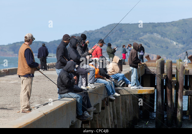 Fishermen on pier - Stock Image