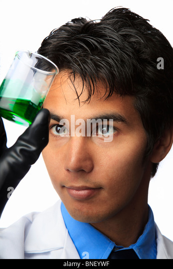 lab technician holding a flask with a fluid inside - Stock Image
