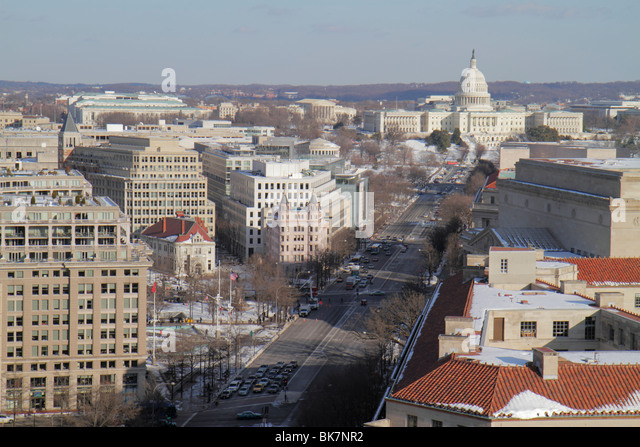 Washington DC Pennsylvania Avenue United States Capitol Building dome rooftops office buildings car traffic view - Stock Image