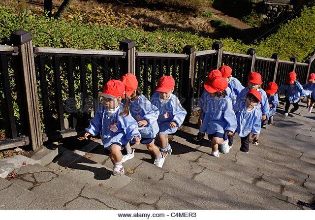 Children on a kindergarten outing in Odawara Castle park, Japan - Stock Image