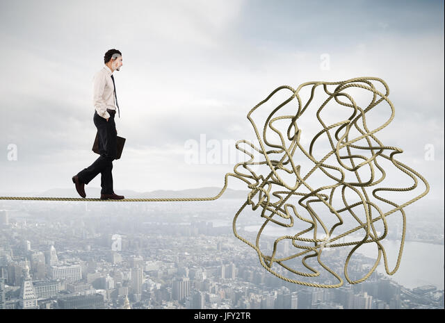 Problem and difficulty concept with tangled rope - Stock Image