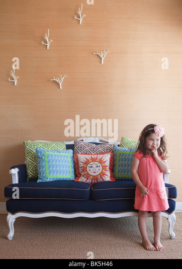 Shy girl in pink sun dress - Stock Image