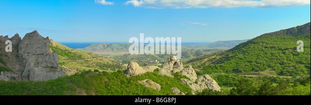 Crimea landscape panorama of Sunny Valley near Koktebel town with Black Sea in the background - Stock Image