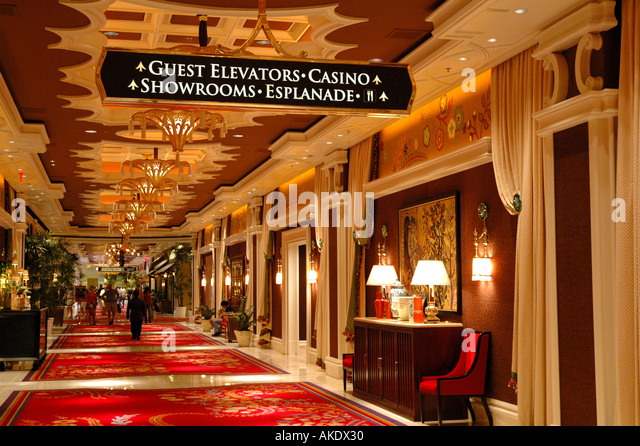 Las Vegas Nevada Wynn Hotel interior hallway going by shops directional sign - Stock Image