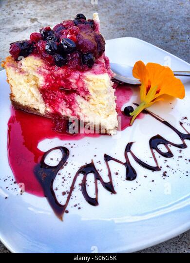 Colorful Country cheese cake in white plate. - Stock Image