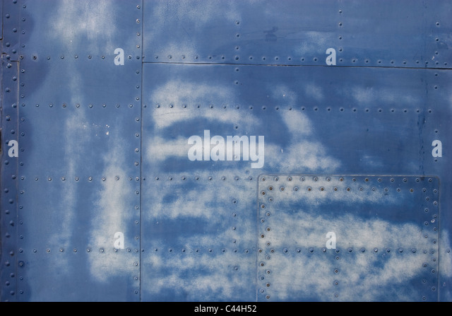 aircraft body close up fuselage paint deteriorate weather poor condition peel fade rivets aluminium skin outer panels - Stock Image