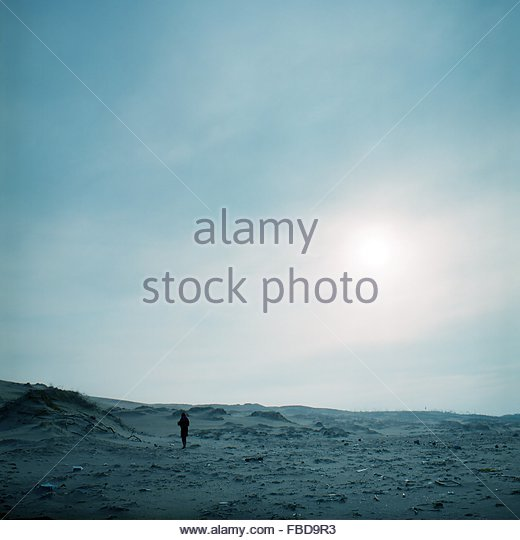 Person On Landscape Against Sky - Stock Image
