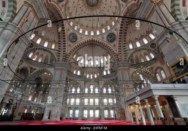 Fatih Mosque, a public Ottoman mosque in the Fatih district of Istanbul, Turkey, with a huge decorated domes & - Stock Image