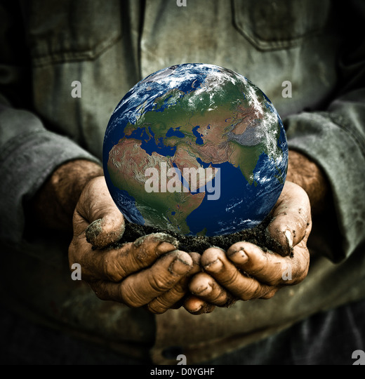 Man holding Earth - Stock Image