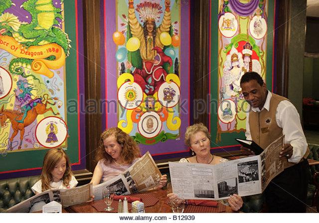 Mobile Alabama Government Street Admiral Semmes Hotel Oliver's Restaurant Mardi Gras paintings panels Black - Stock Image