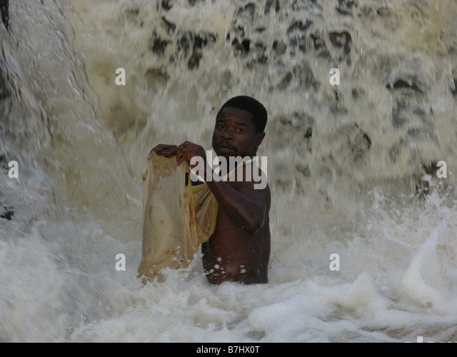 Wagenia fisherman using simple cloth net to scoop tiny fish at Stanley Falls Congo River Democratic Republic of - Stock-Bilder