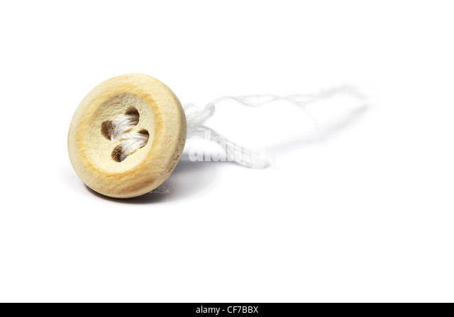 closeup of detached button and thread over white - Stock Image