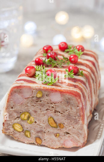 Delicious terrine with ground meat, ham and pistachios - Stock Image