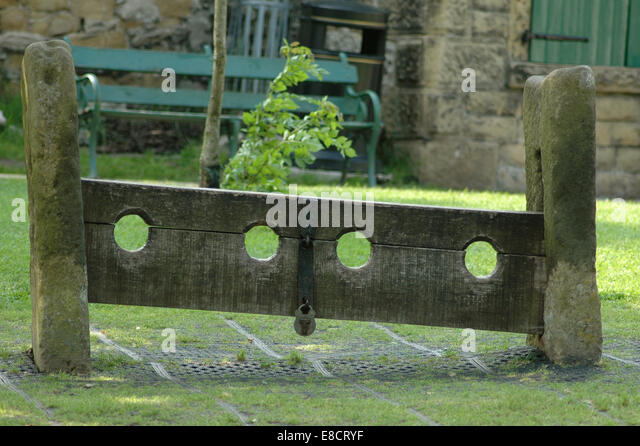 Stocks on the village green at Eyam, Derbyshire - Stock Image