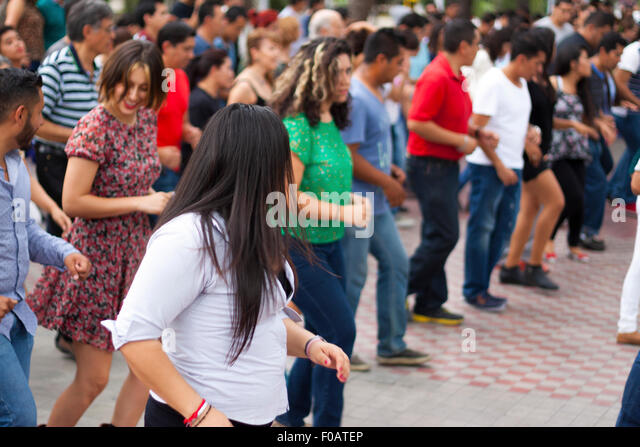 People dancing a cumbia in street. Guadalajara, Jalisco. Mexico - Stock Image