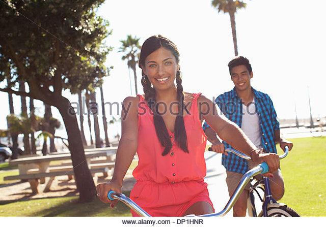 Couple riding bicycles - Stock-Bilder