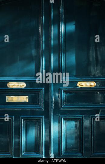 Doors and mail slot, full frame - Stock Image