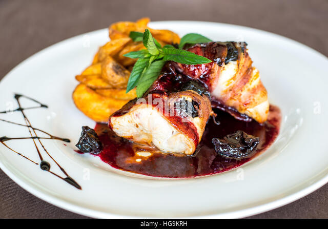 Beautiful and tasty food on a white plate - Stock Image