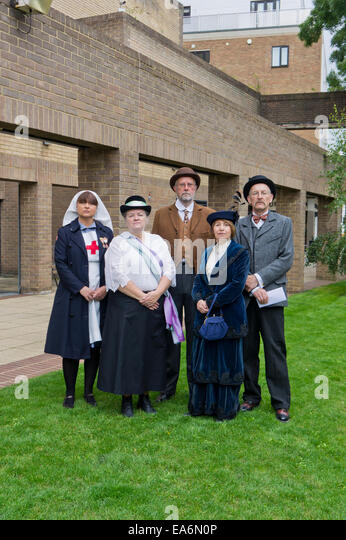 Five re-enactors, three females and two males, in period costume at a WW1 event in Northampton, U&K - Stock Image
