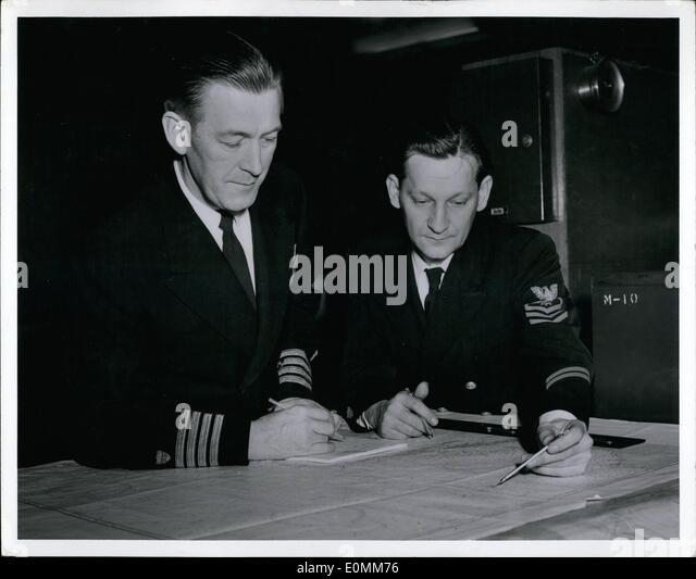 Oct. 10, 1955 - Official u.S. Coast Guard Photograph: Captain Carl B. Oleon (left), Operations and Air officer for - Stock-Bilder