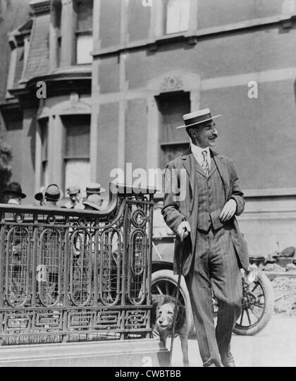 John Jacob Astor IV (1864-1912), walking his dog. He was a talented aristocrat who engaged in business, inventing, - Stock-Bilder