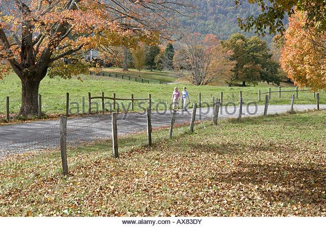 West Virginia Lewisburg rural scenery road fall colors couple walking - Stock Image