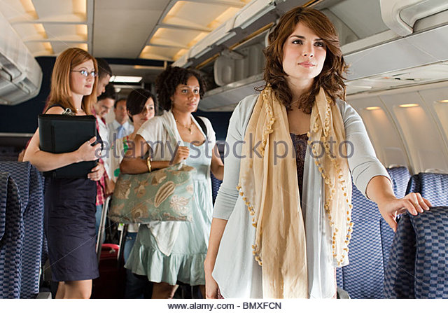 Passengers boarding a plane - Stock Image