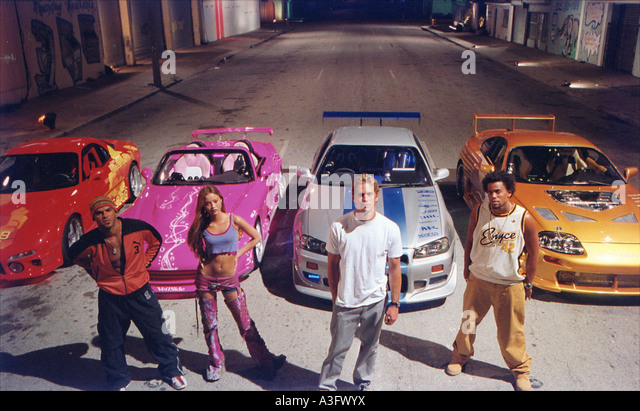 2 FAST 2 FURIOUS Universal 2003 film with from left Amaury Nolasco, Devon Aoki, Michael Ealy and Paul Walker - Stock Image