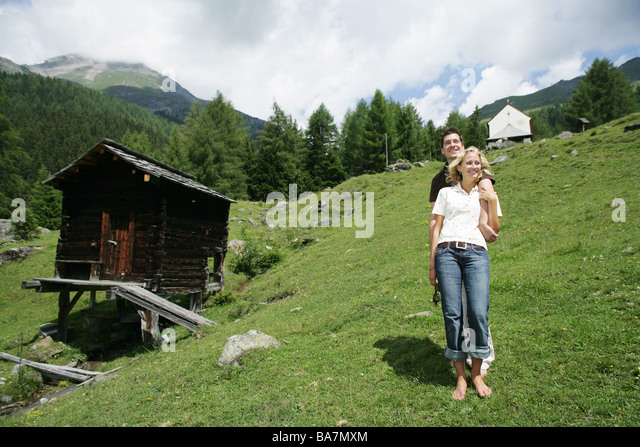 Young couple on alp, Heiligenblut, Hohe Tauern National Park, Carinthia, Austria - Stock Image
