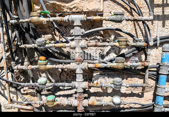 rusty and corroded water mains in domestic building. Photographed in Jerusalem, Israel - Stock Image