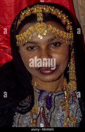 Oman.  Woman with Gold Jewelry Headdress and Necklace. - Stock Image
