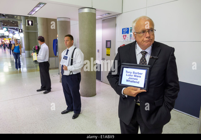 Brisbane Australia Queensland Brisbane Airport BNE terminal concourse drivers holding signs names man transportation - Stock Image