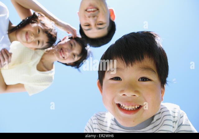 Happy Japanese family smiling - Stock Image