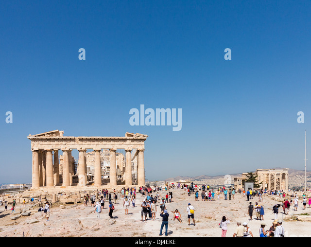 Acropolis, Athens, Greece - with crowds of tourists visiting the site Parthenon and The Erechtheion - Stock Image