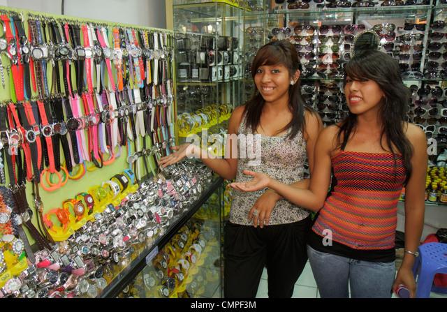 Peru Tacna Avenida Bolognese Central Market shopping business fashion watches accessory Hispanic girl teen salesclerk - Stock Image