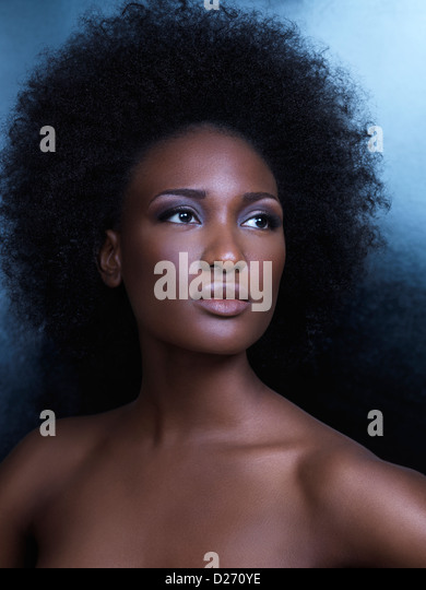 Beauty portrait of a young african american woman with big natural hair - Stock-Bilder