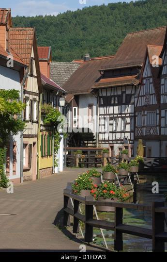 The Corn Mill Lane and mill wheel, Wassergasse, Annweiler am Trifels, Rhineland Palatinate, Germany, Europe - Stock-Bilder