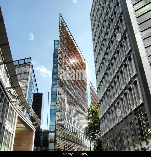 England, London, Modern architecture reflecting sun rays - Stock Image