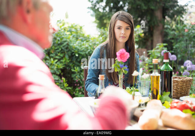Young woman having lunch outdoors - Stock Image