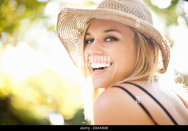 Close up portrait of young woman in park - Stock Image