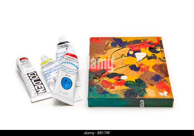 Tubes of artists acrylic paints beside a finished abstract work - Stock Image