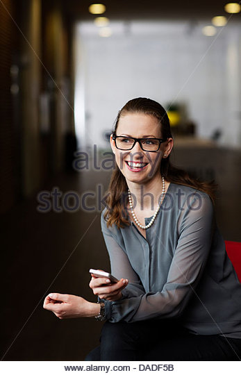Business woman with mobile phone - Stock Image