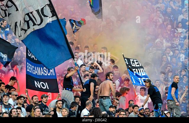 Atalanta Soccer fans waving flags at the Atleti Azzurri stadiu, in Bergamo, Italy. - Stock Image
